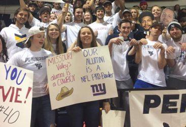 students cheering at a game